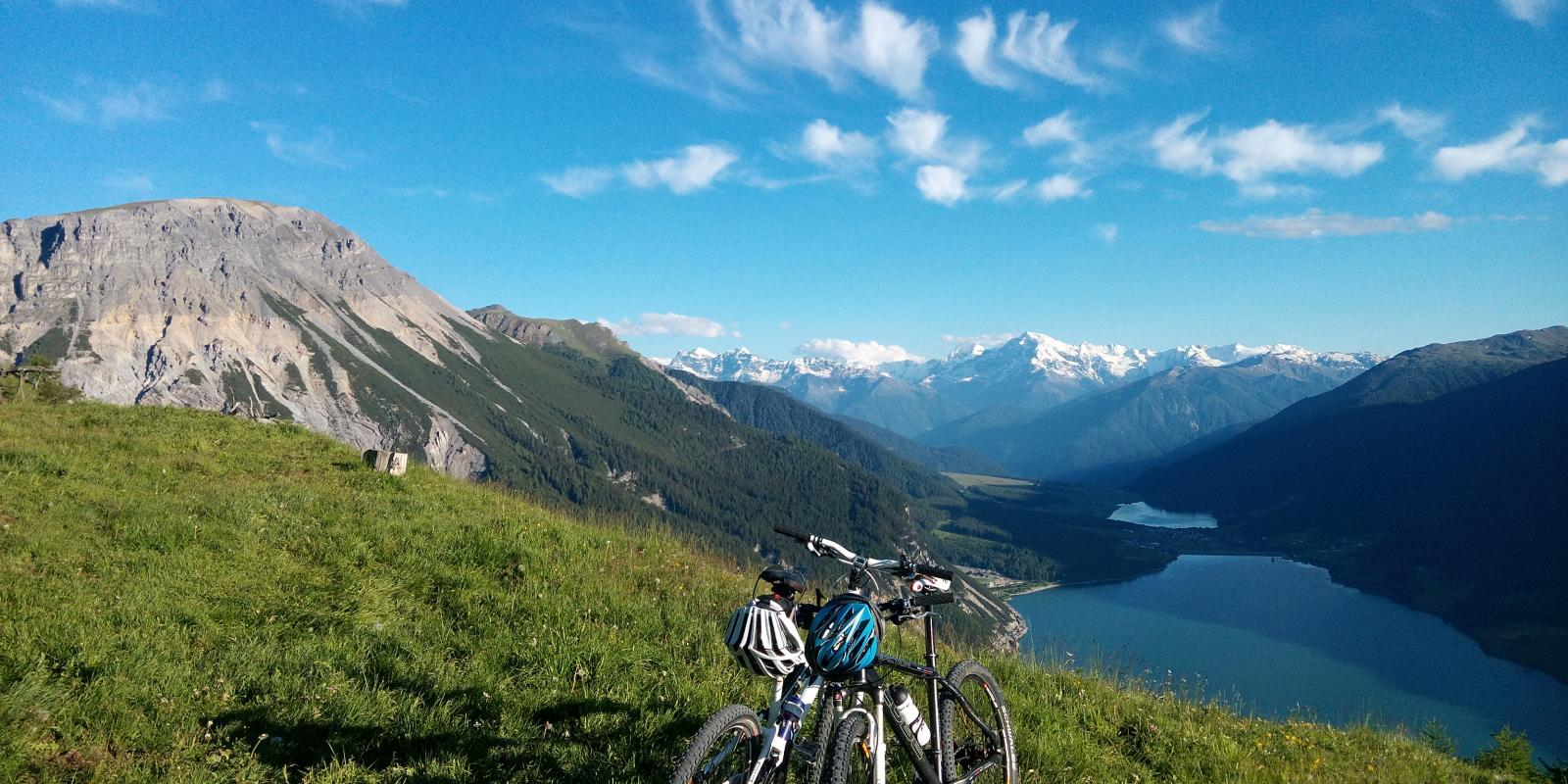 Biketour with view on the Resia lake