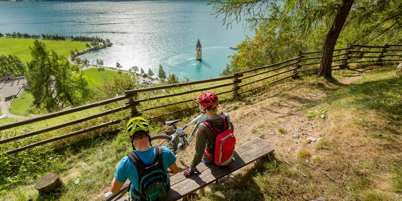 Mountain bike with a view on the Resia lake